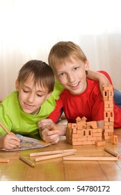 Two brothers are building  of a toy castle