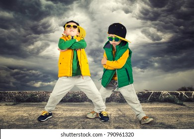 Two brothers dancing break dance.Hip-hop style.The cool kids. Children's fashion.