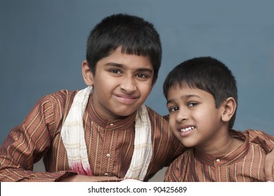 two brothers looking very happy in traditional indian dress