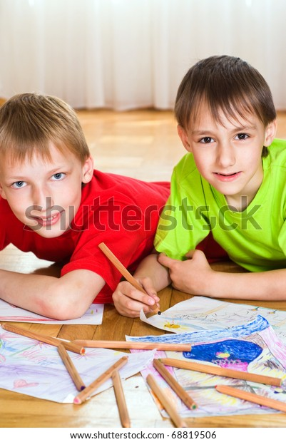 Two Brothers Lying On Floor Draw Stock Photo Edit Now 68819506