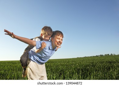 two brothers outdoors happy play