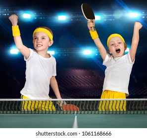 Two brothers play ping-pong.The joy of victory.
