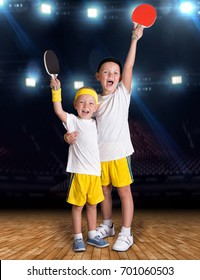 Two brothers play tennis in the sports hall.Champions.