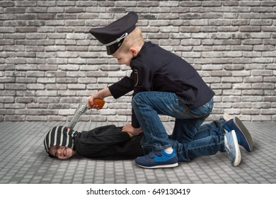 Two brothers playing COP and criminal .