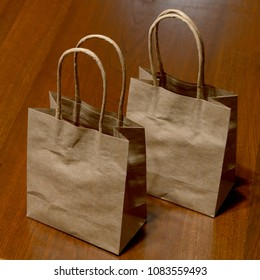 Two brown bags for a more eco-friendly shopping experience.
