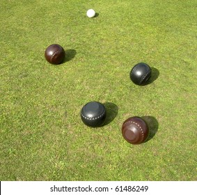 Two brown two black bowls and jack