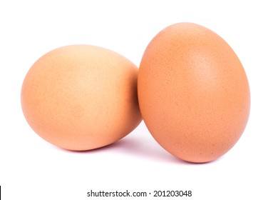 Two brown chicken eggs isolated on white background