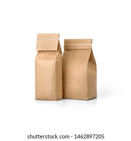 Two Brown craft paper bags packaging template with stitch sewing isolated on white background. Packaging template mockup collection. Stand-up pouch composition. Front view package