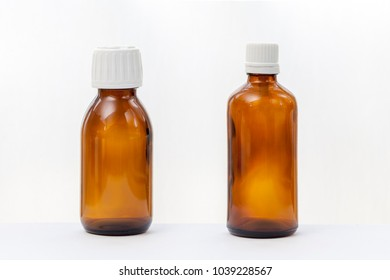 two brown glass botlle for medical syrup isolated on white