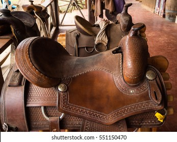 Two Brown horse's Saddle on the wooden shelf