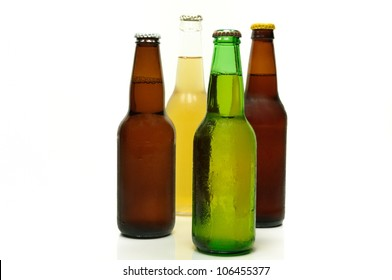 Two brown, one green and one clear bottles of beer.