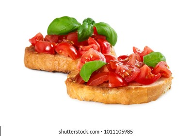 Two bruschetta with fresh tomato and basil isolated on white background.