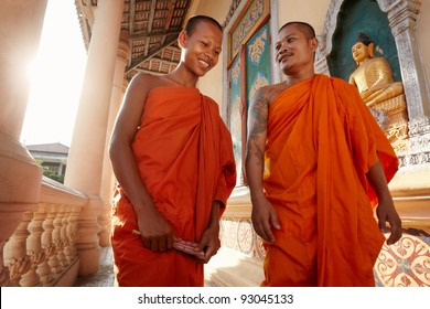 Two buddhist monks meeting and saluting in a temple, Phnom, Penh, Cambodia, Asia. Dolly shot