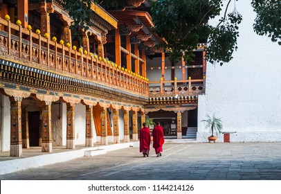 Two buddhist monks at Punakha Dzong, Bhutan