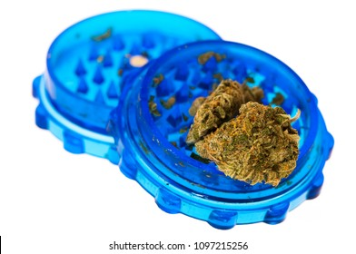 Two buds of herbal marijuana in a plastic grinder