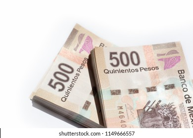 two bundles of 500 mexican pesos bills on white background top view