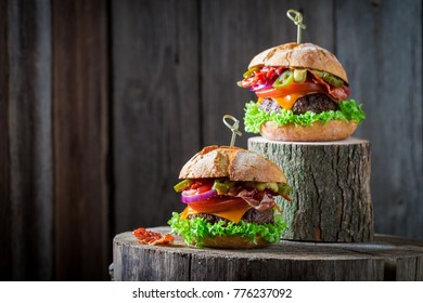 Two burger with onion, tomato and lettuce and bacon
