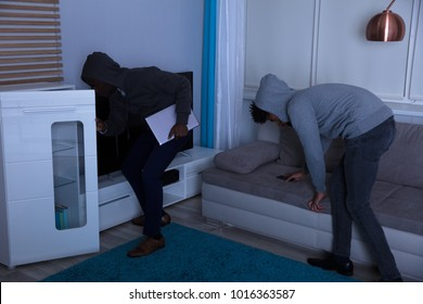 Two Burglar In Hooded Top Stealing Laptop And Cellphone In The House At Night
