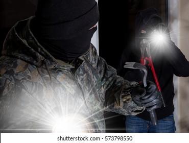 Two burglars enter a house