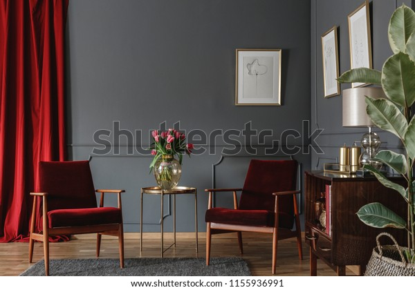 Burgundy And Grey Living Room.Two Burgundy Armchairs Placed Grey Living Stock Image