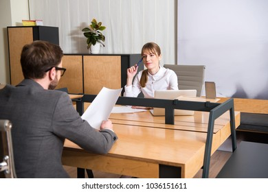 Two business colleagues having meeting at workplace