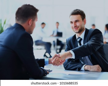 Two business colleagues shaking hands.