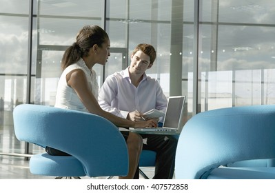 Two business colleagues sitting at a table, having a meeting