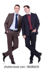 two business friends standing shoulder to shoulder, one looking at the other, over white background