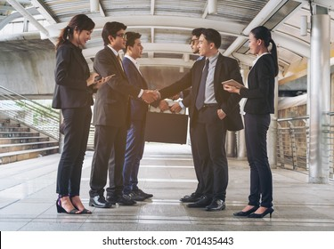 Two business group of executives, businesswomen, businessmen are in business meeting. Concept of business agreement, handshake, mergers and partnership.