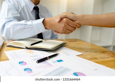 Two Business handshake and business people after discussing good deal of Trading contract and new projects for both companies, success, partnership, co worker . Meeting and greeting concept.