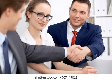 Two business man shaking hands to each other finishing up the meeting