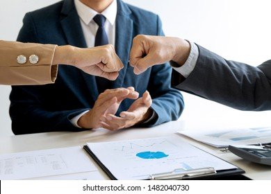 two business man use hand to fist bump for succes teamwork coporate with another staff group