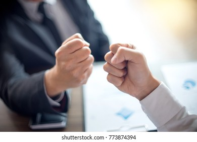 two business man use hand to fist bump for succes teamwork coporate