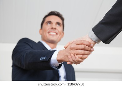 Two business manager shaking hands in the office