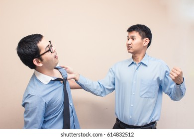 two business men have problem conflict, fighting, try to knock other one out