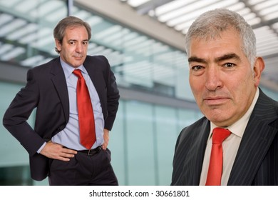 two business men portrait standing in a modern building