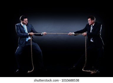 Two business men pulling rope in a competition, isolated on white background.