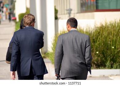 Two business men walking