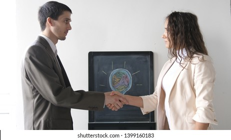 Two business partner shake hands when meeting between a man and woman in suit. Successful deal.