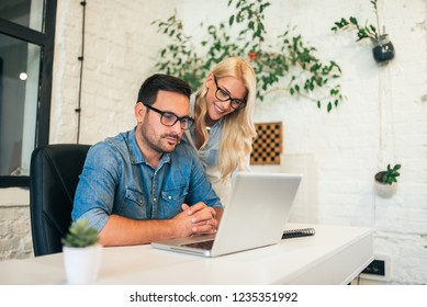 Two business partners at work in bright office.
