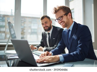 Two business partners working with laptop together