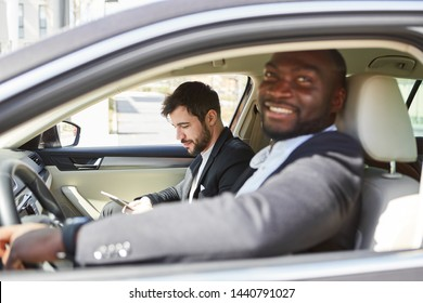 Two business people in the car on business trip or on the way to the office