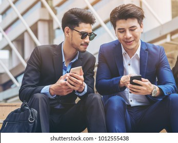 Two business people discuss business affair on mobile phone. Communication technology and business concept.