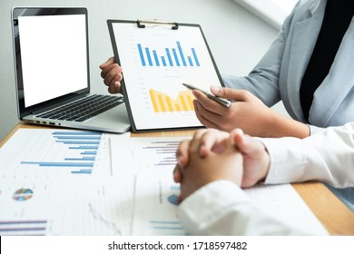 Two business people are discussing about business graph and planning strategy in the office, Business and finance concept.