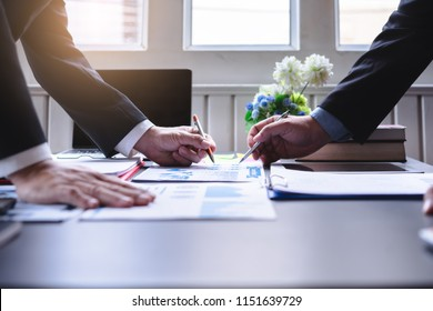 Two business people discussing financial reports.board of directors planning project, considering business offer, sharing ideas for Business report.