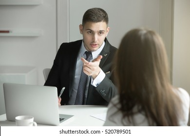 Two business people having a dialogue between, intended to reach a beneficial outcome; man from human resource management interviewing a lady; boss scolding his worker. Business concept photo