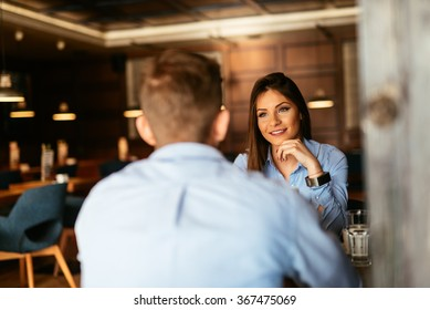 Two business people having an informal meeting in a cafe.
