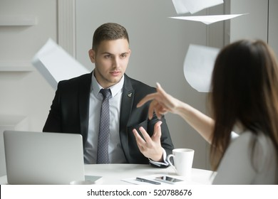 Two business people at a heated dispute or argument, the process of negotiation breaks down, misunderstanding, agreement cannot be reached. Woman is throwing papers. Business concept photo