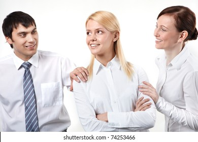 Two business people patting his colleagues on shoulder