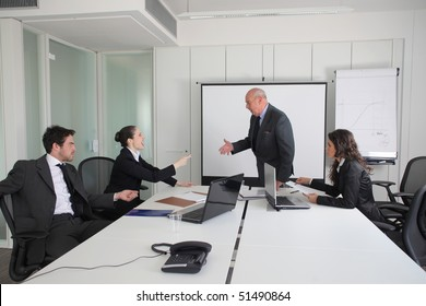 Two business people quarreling during a meeting with two other business people